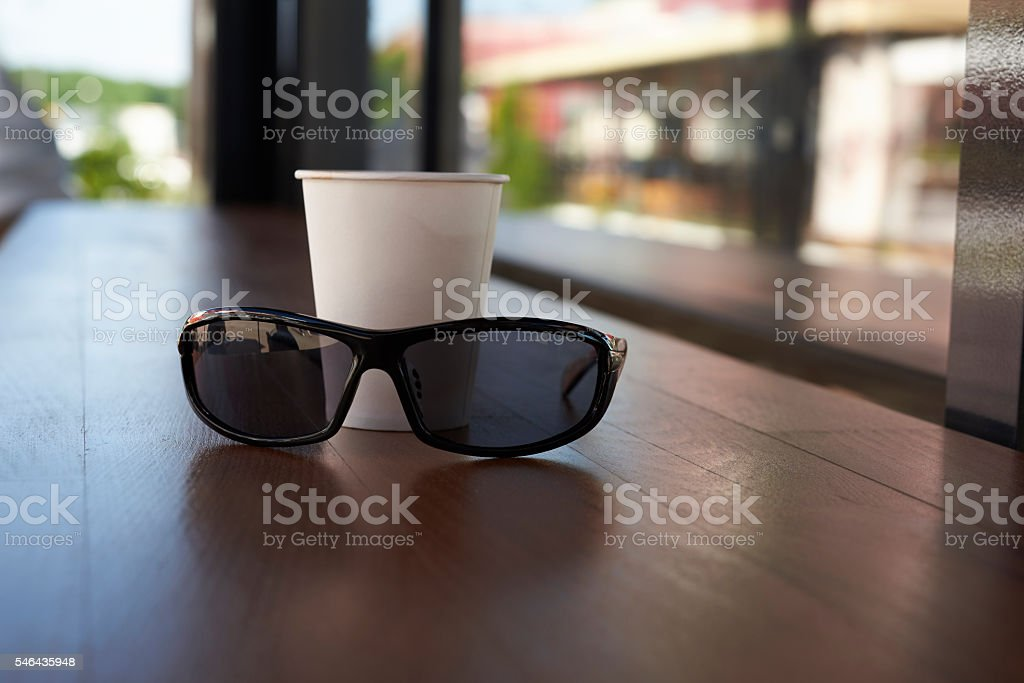 sunglasses and a paper cup stock photo