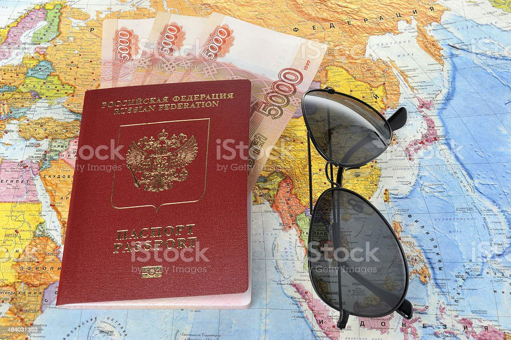 Sunglasses and Russian international passport with money on the stock photo