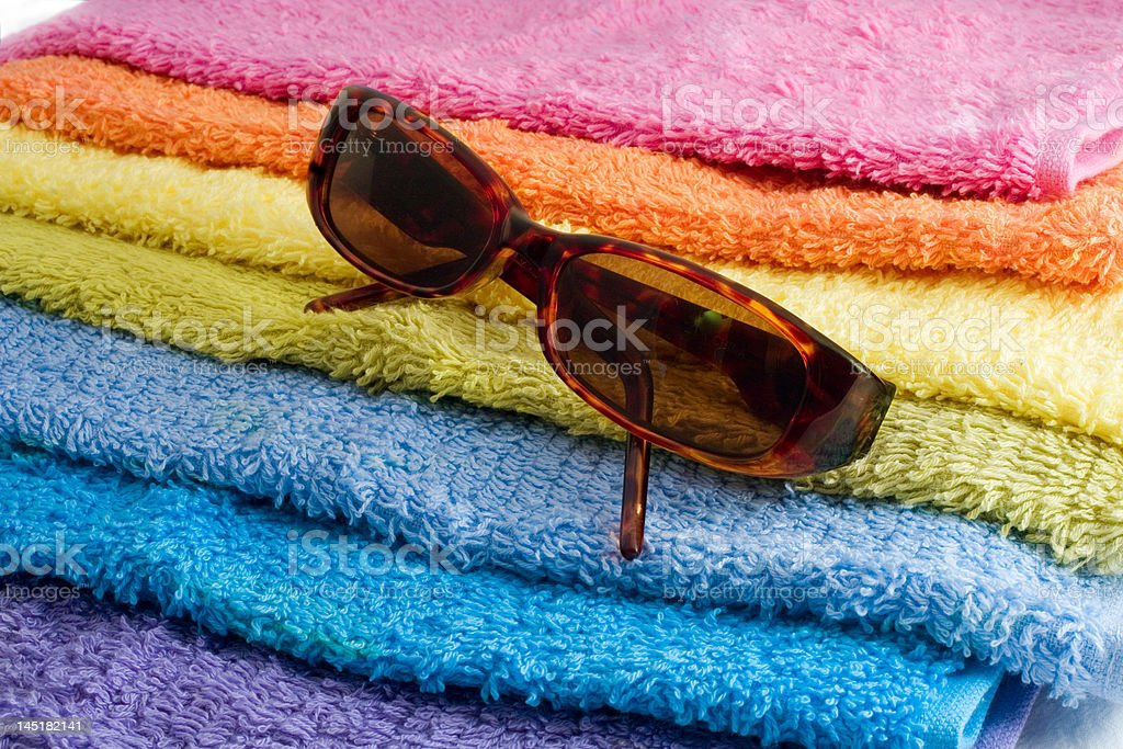 sunglasses and towels royalty-free stock photo