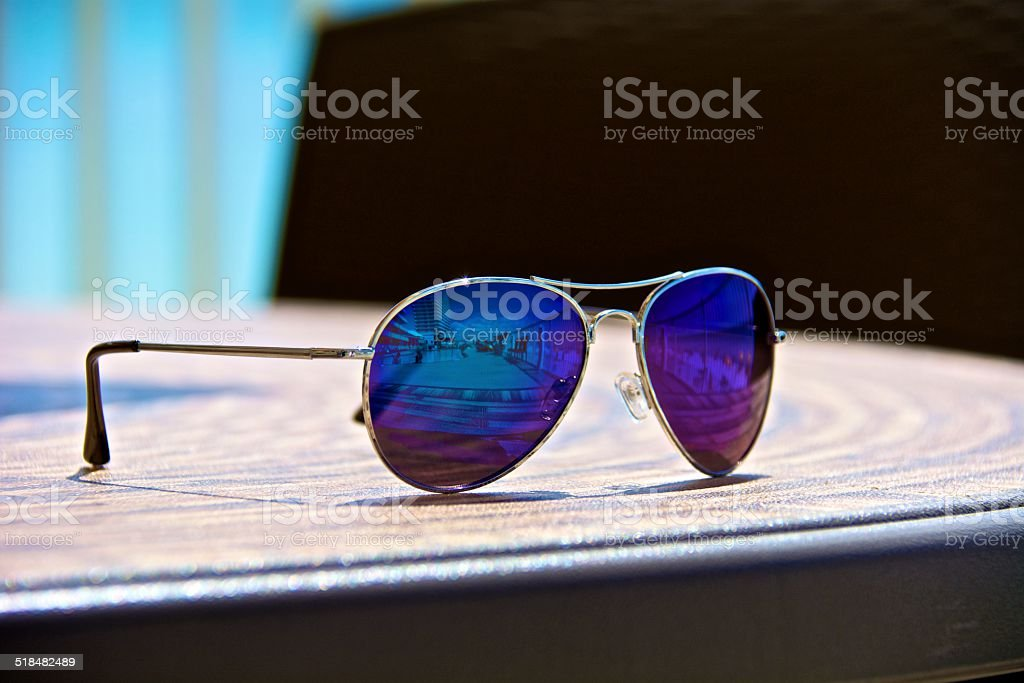 Sunglasses by the pool stock photo