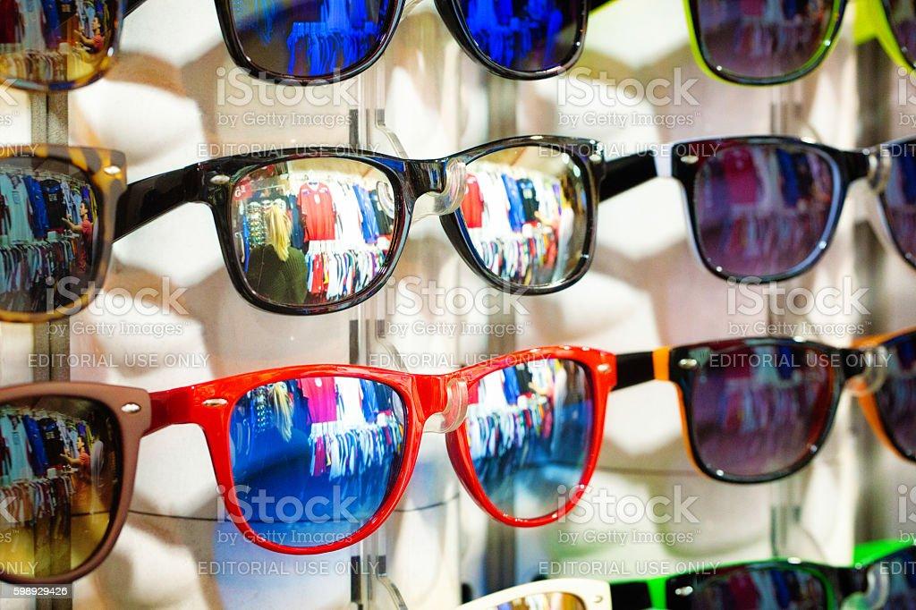 Sunglasses display at street market stock photo