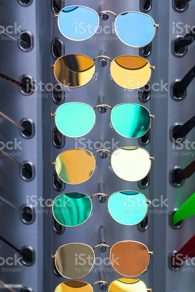 Sunglasses displayed at street market for sale stock photo