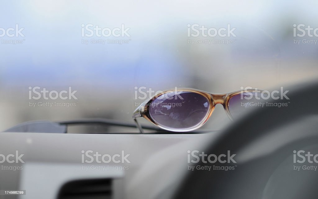 Sunglasses in modern car royalty-free stock photo
