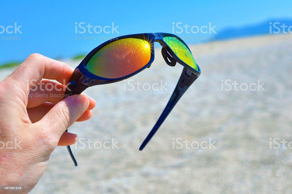 Sunglasses in my hand stock photo
