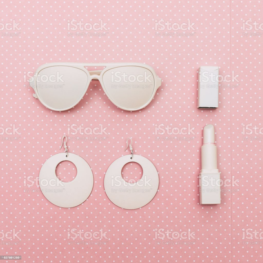 sunglasses, lipstick and earrings stock photo