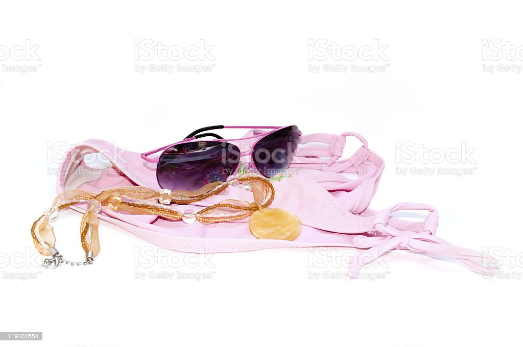 Sunglasses, necklace and swimsuit stock photo