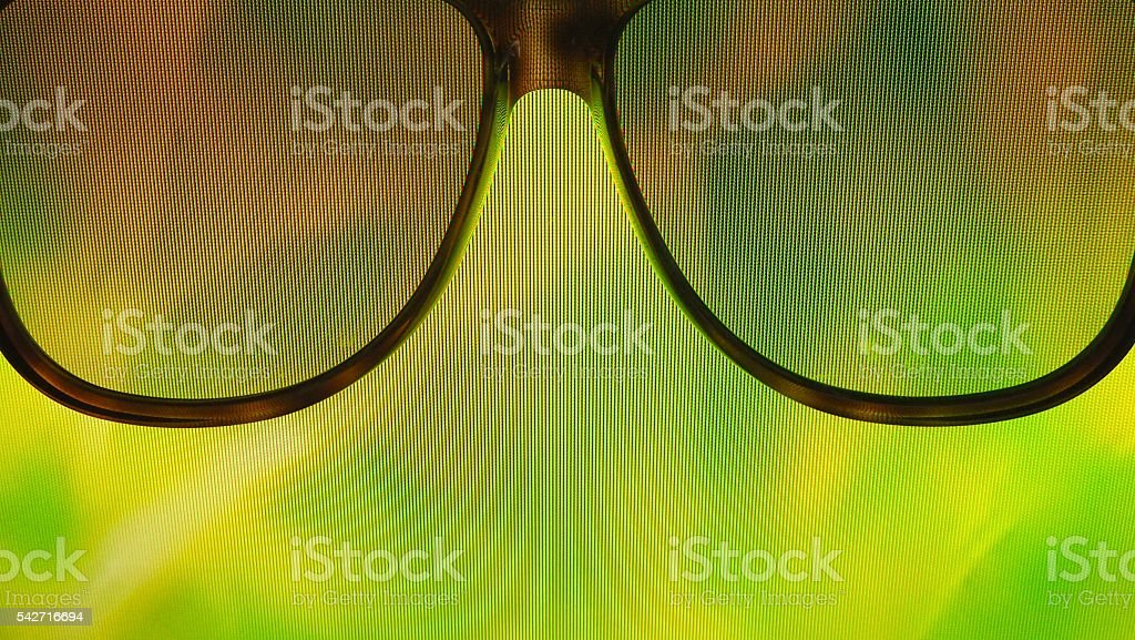 Sunglasses on green forest background stock photo