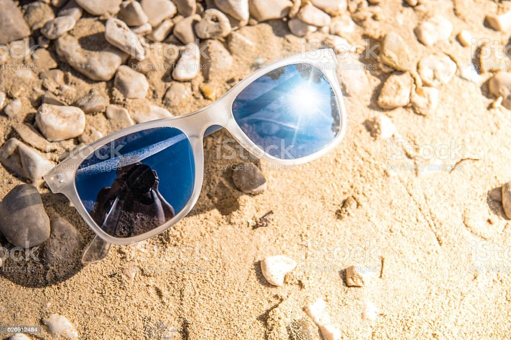 Sunglasses on Rocky Beach stock photo