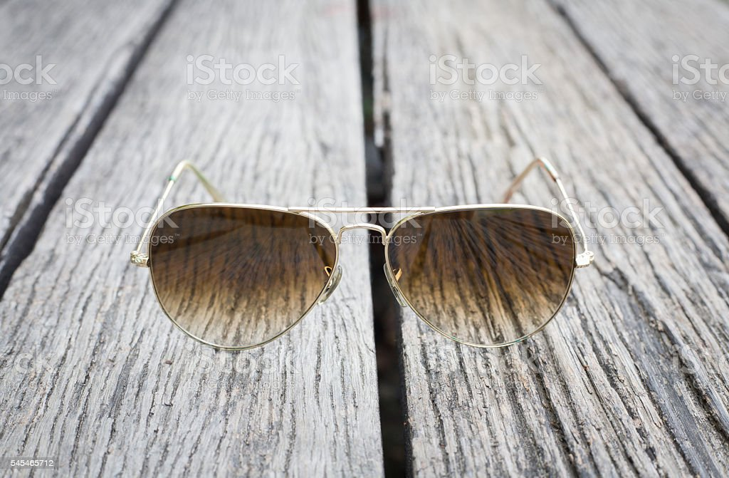 Sunglasses on the old wooden floor. stock photo