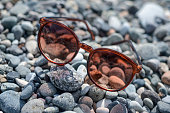sunglasses on the pebbles, vacation concept