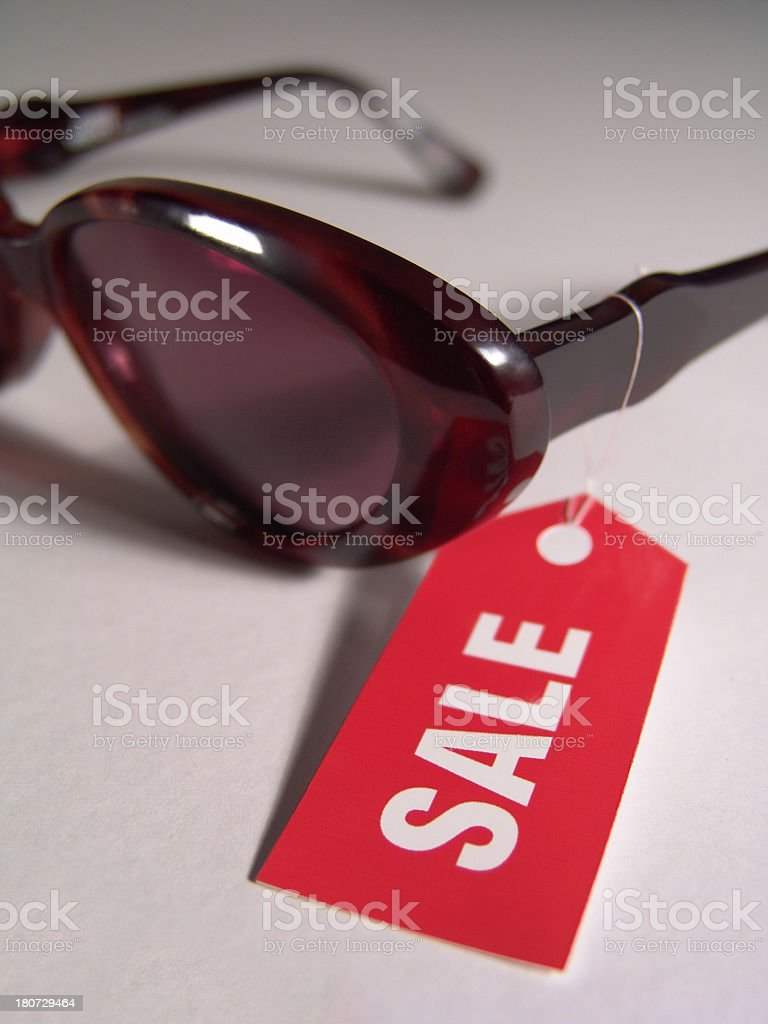 Sunglasses with a red sale tag stock photo