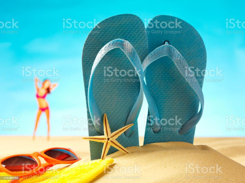Sunglasses with Flip Flops and Female in a Bikini royalty-free stock photo