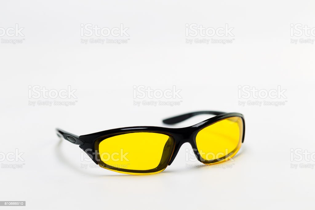 Sunglasses with yellow lenses on a white background stock photo