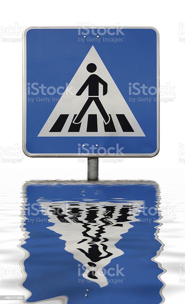 sunken blue crosswalk sign stock photo