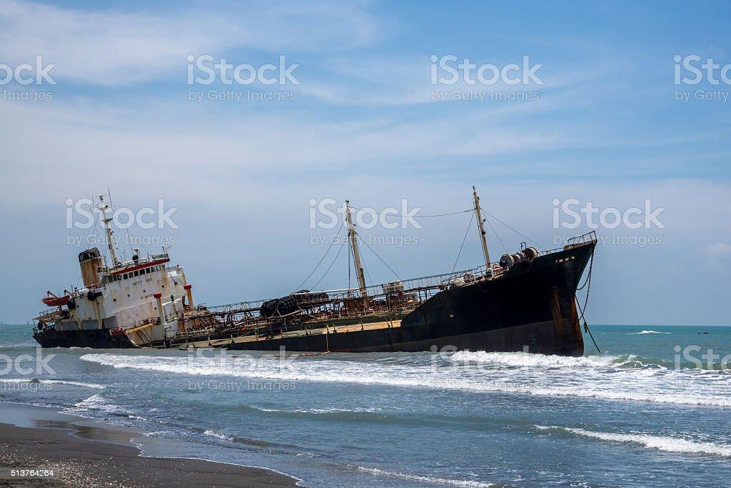Sunken boat at beach stock photo