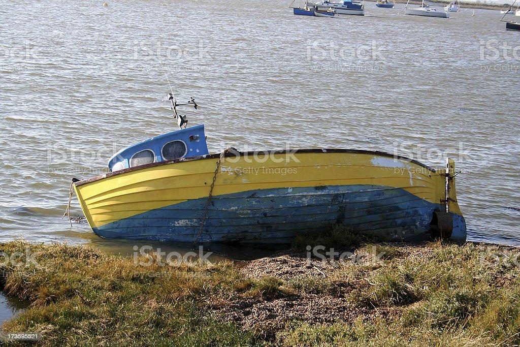 Sunken boat on river stock photo