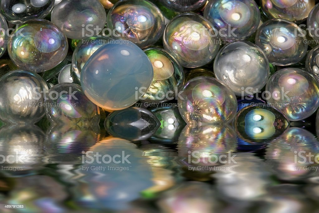 sunken iridescent glass beads stock photo