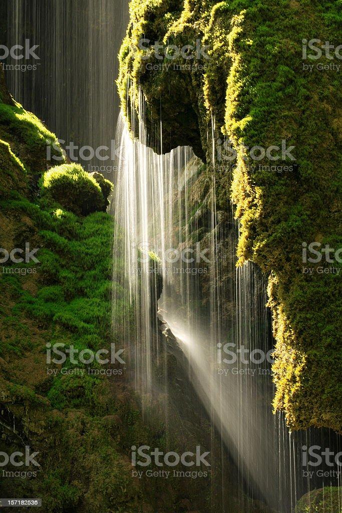 Sunlight and Mossy Waterfall stock photo