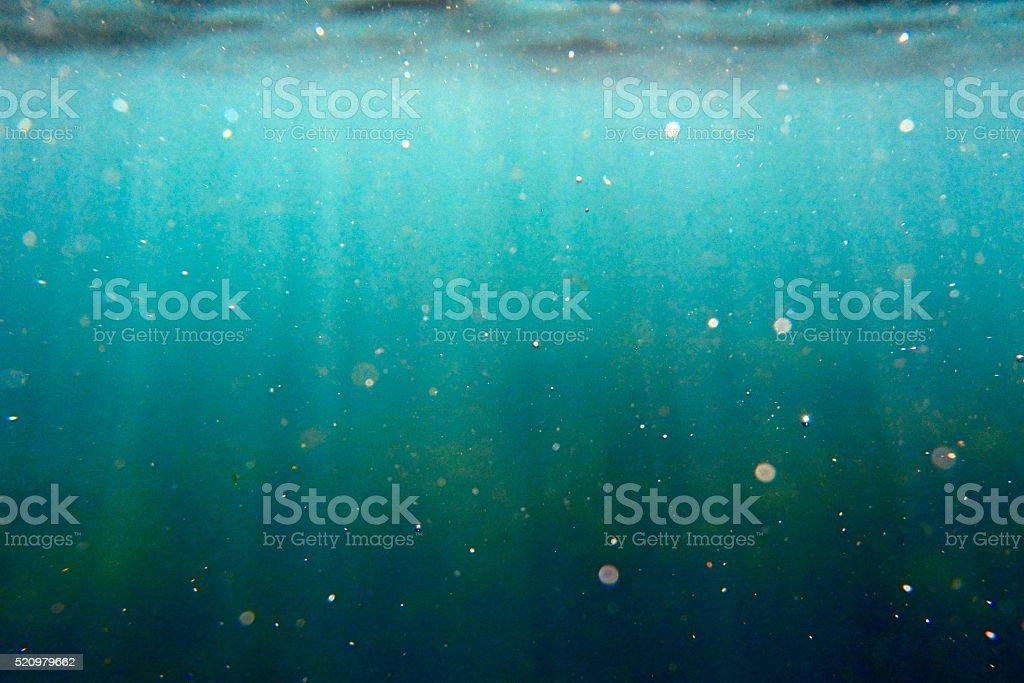 Sunlight and sea wash stock photo