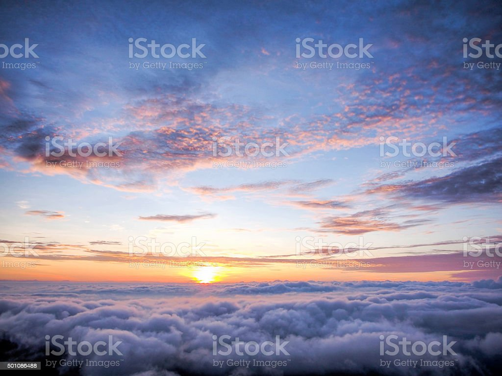 sunlight and sunrise above of fog stock photo