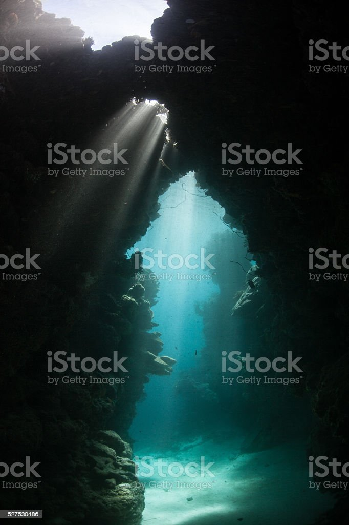 Sunlight and Underwater Cavern stock photo