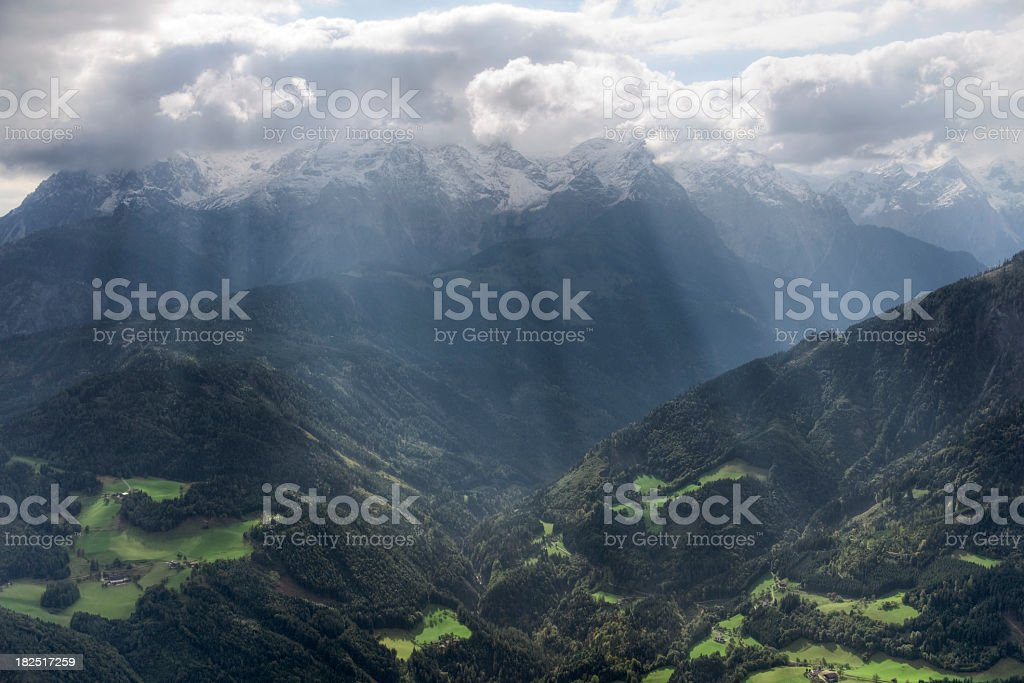 Sunlight Break in the Alps stock photo