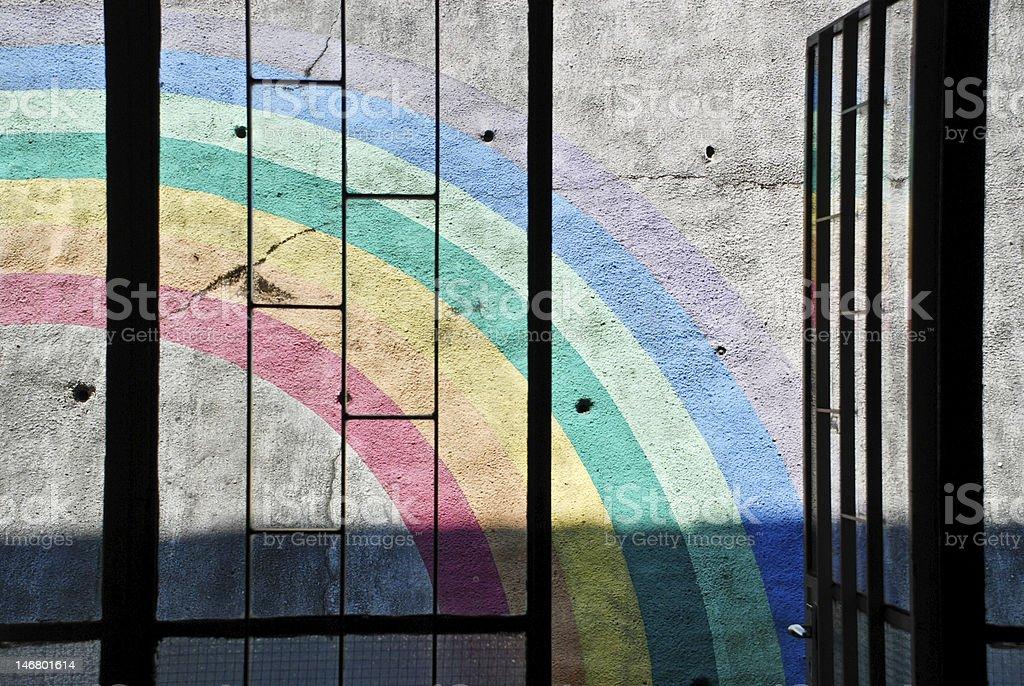 Sunlight cast on rainbow painting outside window stock photo