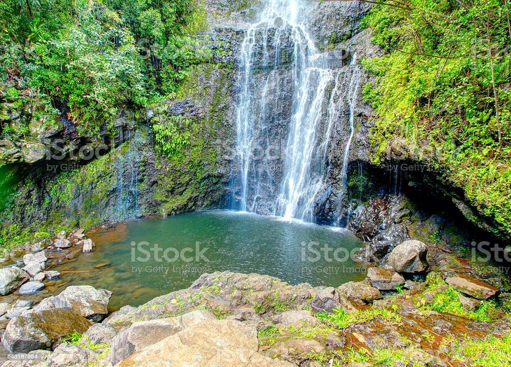Sunlight coming through waterfall in Maui Hawaii stock photo