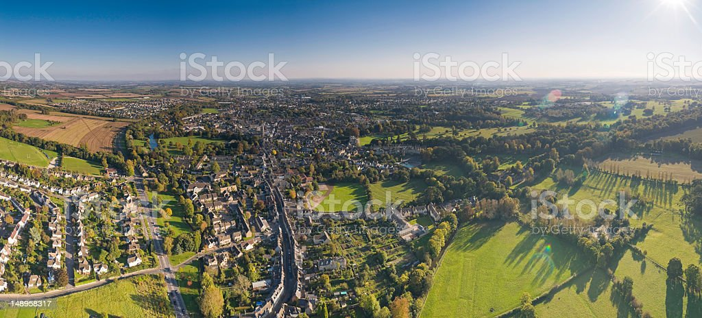 Sunlight flaring over Cotswold town royalty-free stock photo