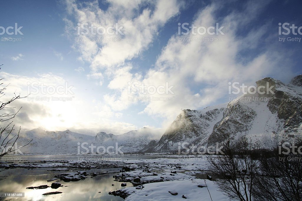 Sunlight hitting the mountains with snow royalty-free stock photo