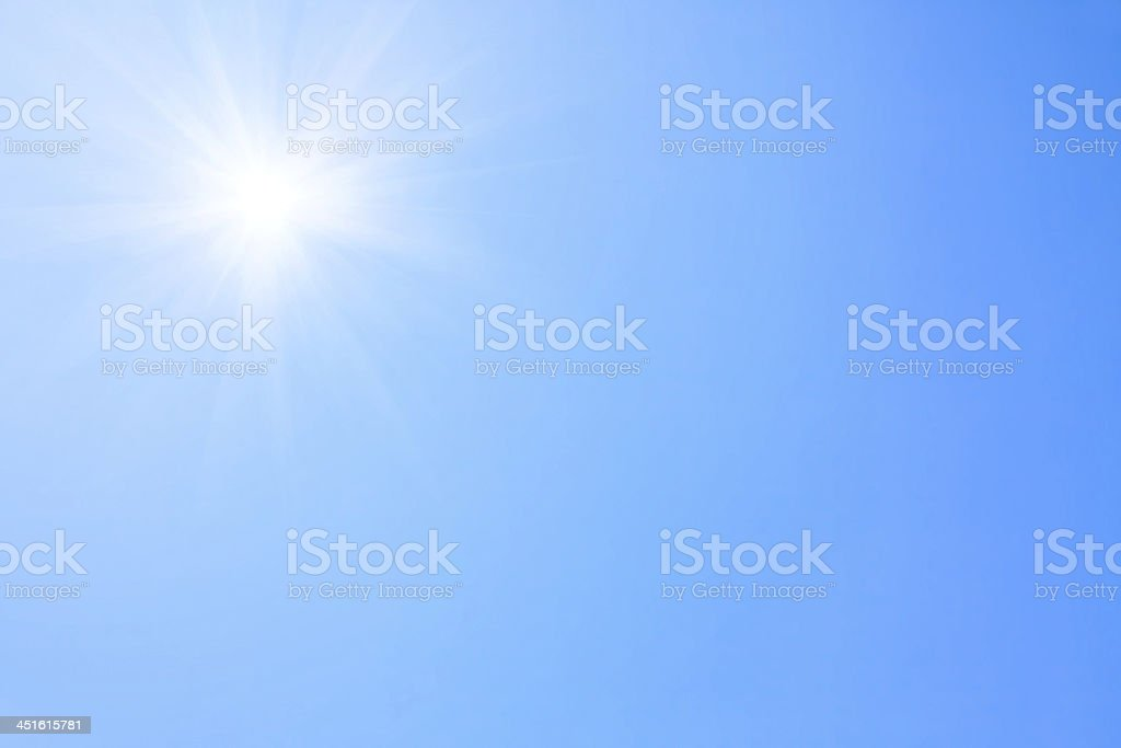 Sunlight in blue sky. stock photo