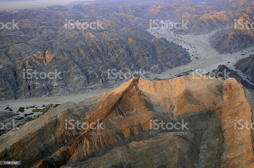 Sunlight on an mountain in the desert stock photo