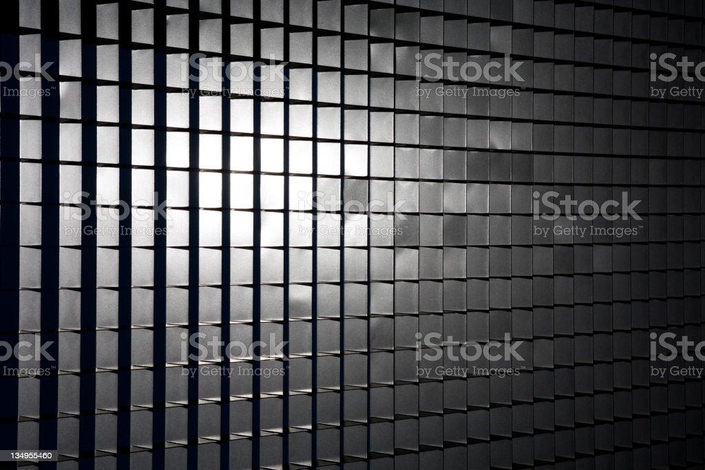 Sunlight on metal grid stock photo