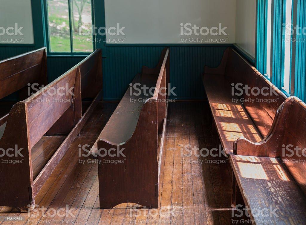 Sunlight on the church pew stock photo