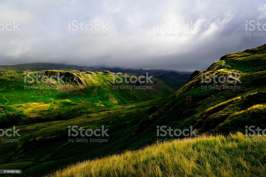 Sunlight over Scafell stock photo