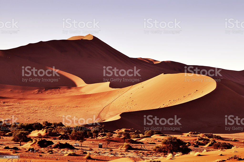 Sunlight over Sossusvlei in Namib desert stock photo