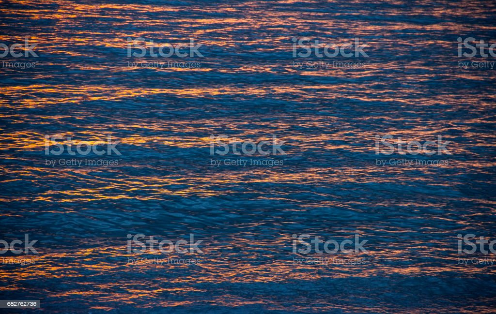 sunlight playing on sea background stock photo