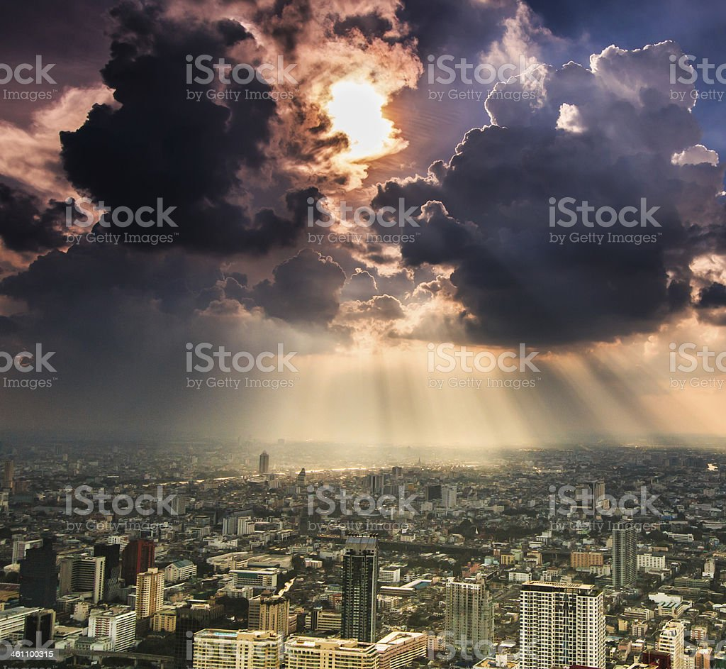 Sunlight rays shining on Bangkok, Thailand stock photo