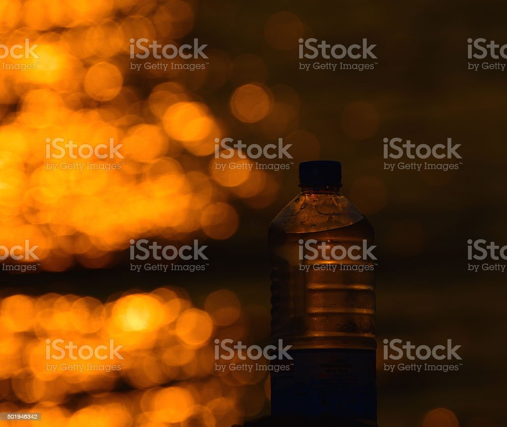 Sunlight reflection with water bottle object stock photo