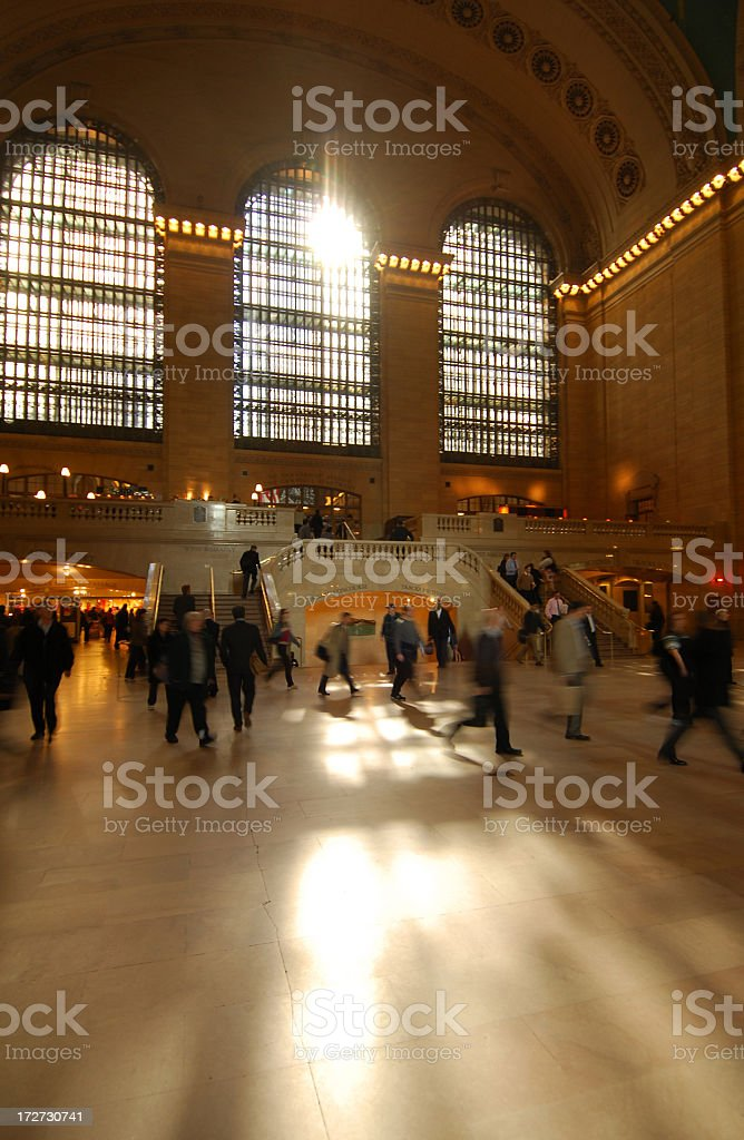 Sunlight shining into busy Grand Central Station stock photo
