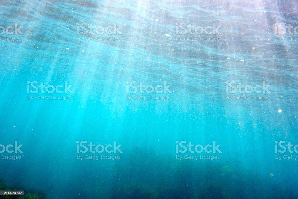 Sunlight shining through the sea stock photo