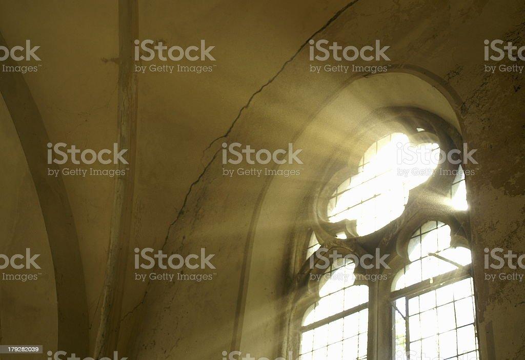 Sunlight streams through a large gothic designed window stock photo