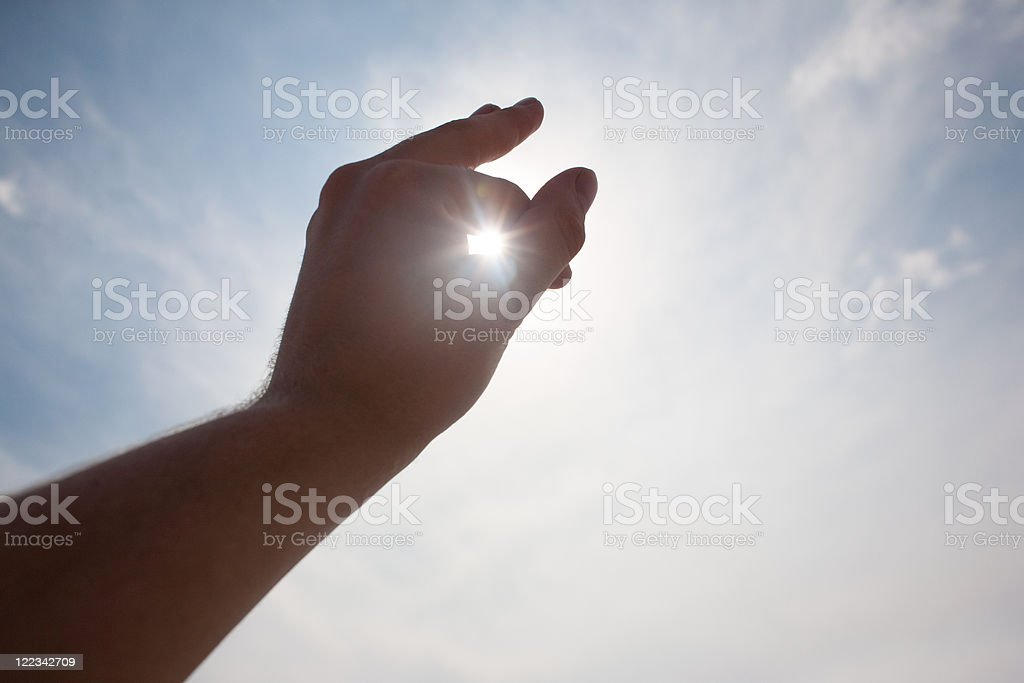 Sunlight through a hand stock photo
