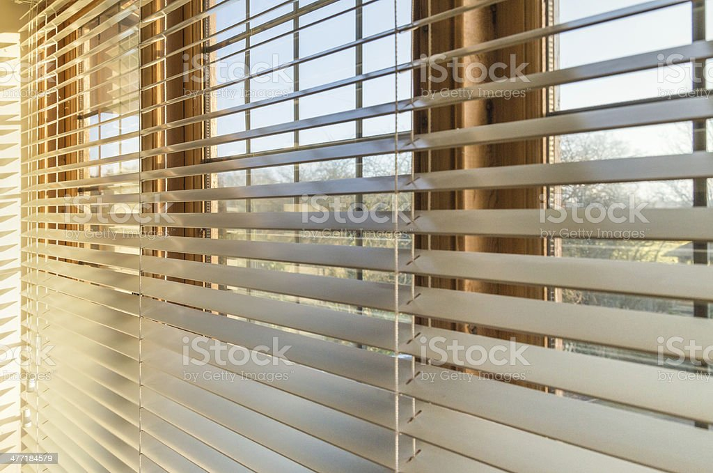 Sunlight through blinds stock photo