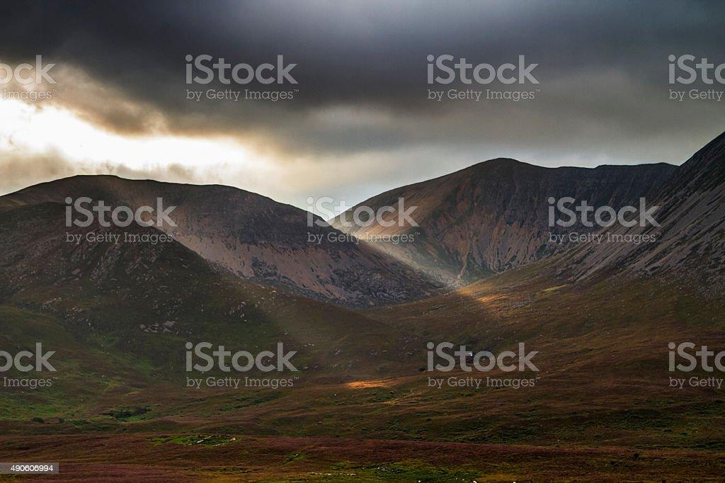 Sunlight through clouds, Isle of Skye stock photo