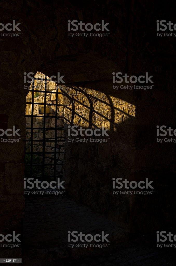 Sunlight through dungeon bars at Kalemegdan fortress, Belgrade stock photo
