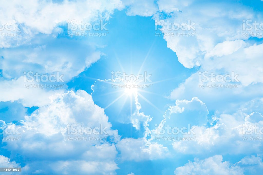 Sunlight through multiple exposure of clouds stock photo
