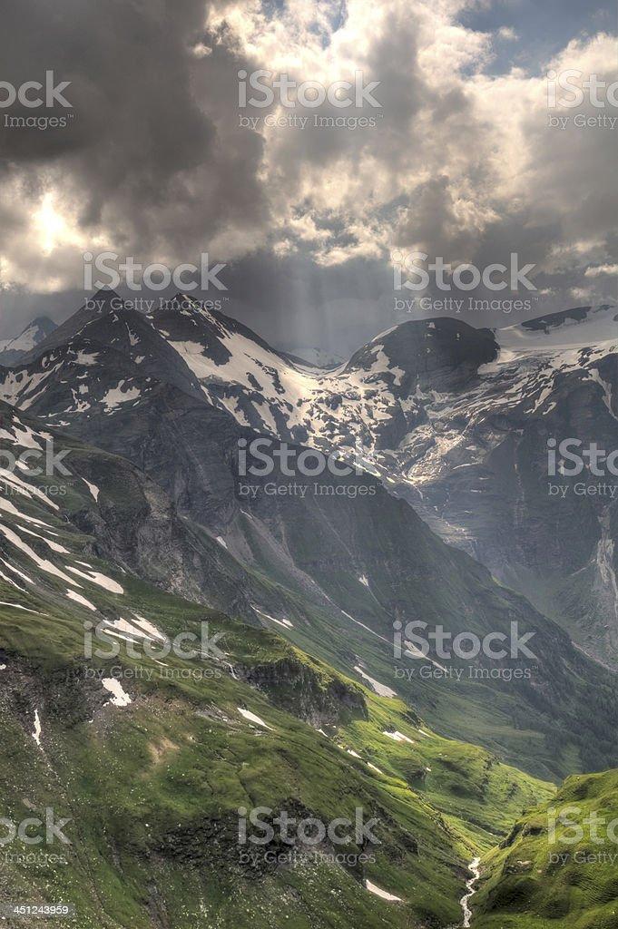 Sunlight through the storm clouds on Glacier Pasterze. Austrian Alps stock photo