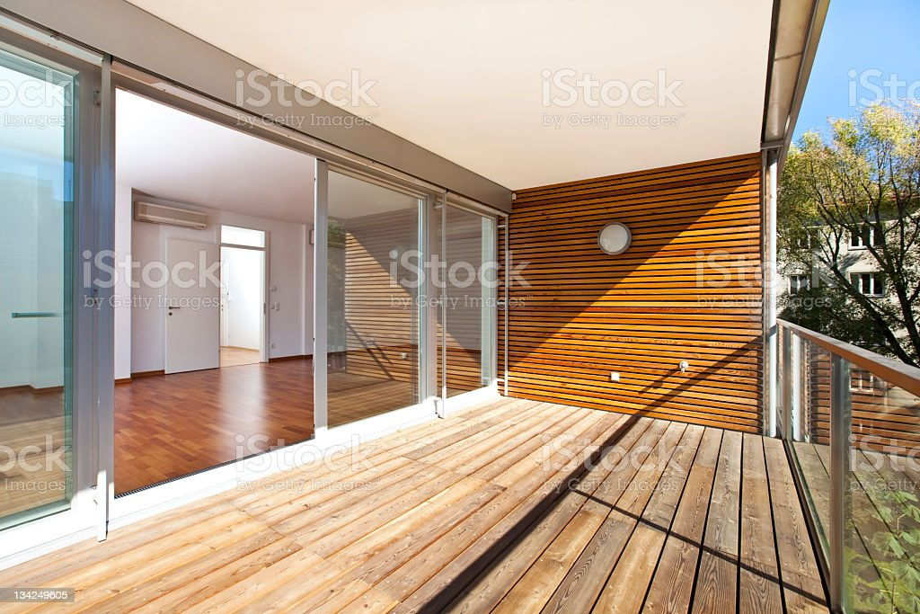 sunlit balcony of contemporary architecture stock photo