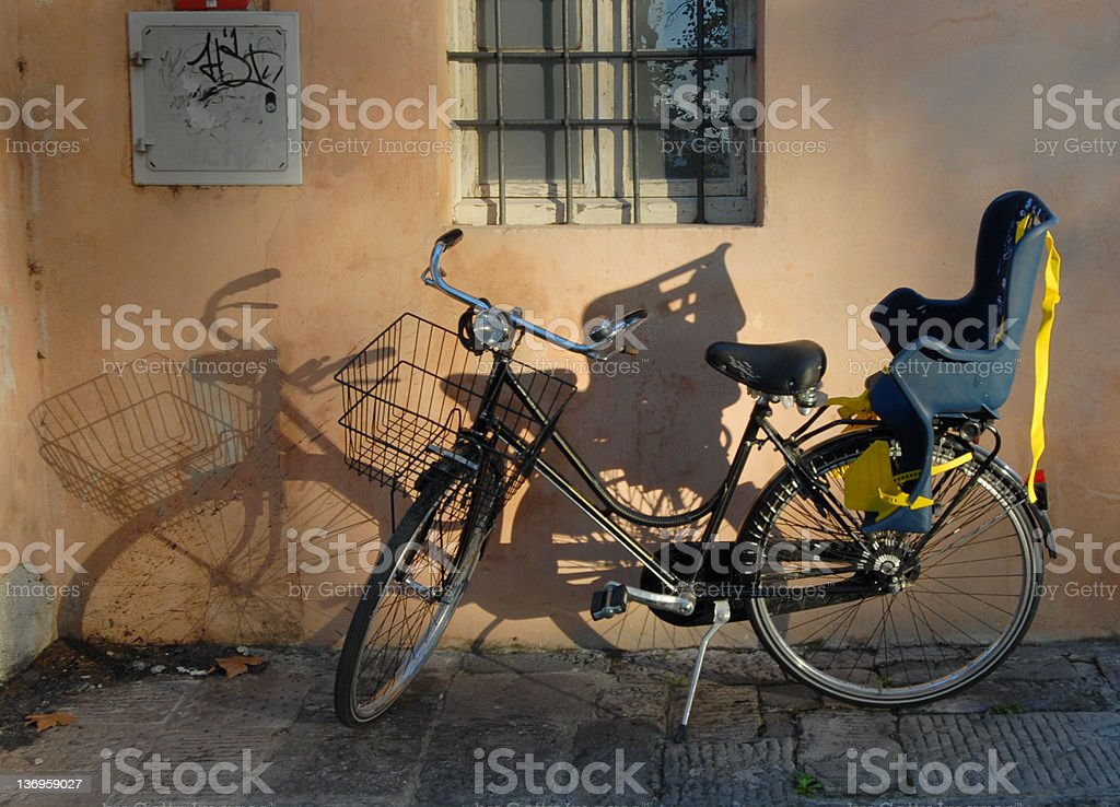 Sunlit Bicycle with Child's Seat stock photo